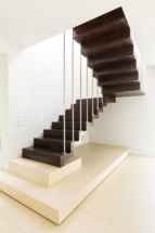 bright-minimalist-hall-with-wooden-stair-PV3K4RJ